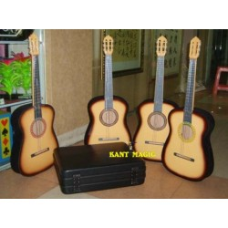 FOUR APPEARING GUITARS FROM SUITCASE